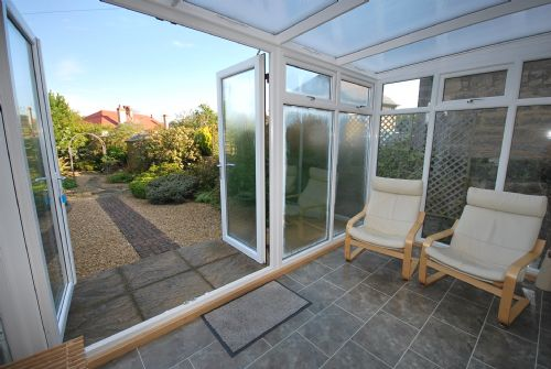 Conservatory opening out to garden