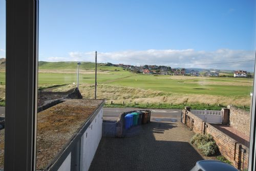 Overlooking golf course and off-street parking