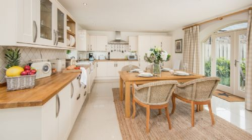 Large dining kitchen with access to garden