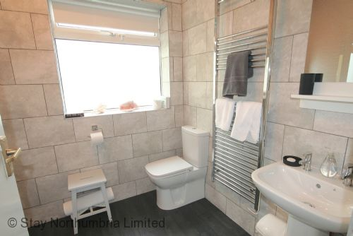 New modern downstairs bathroom, bath with shower over....