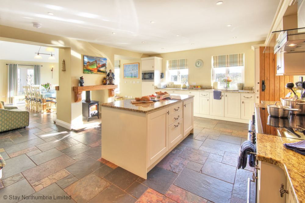 Spacious Kitchen through to diner with double sided log burner