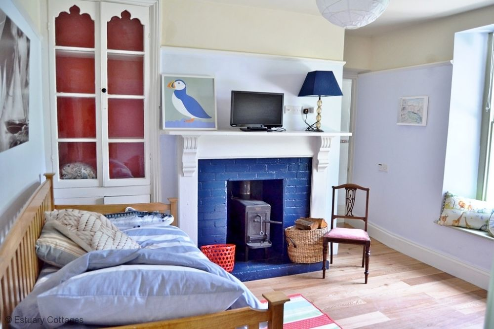 Second sitting room or extra bedroom with woodburner