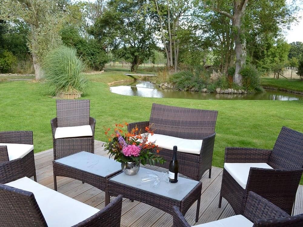 Enclosed lawned garden with decked terrace, outdoor furniture and barbecue
