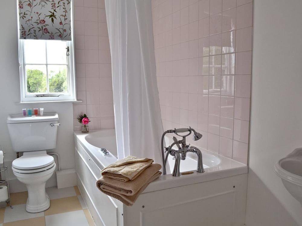 Larkin Farmhouse first floor: Family bathroom with a shower attachment over the bath
