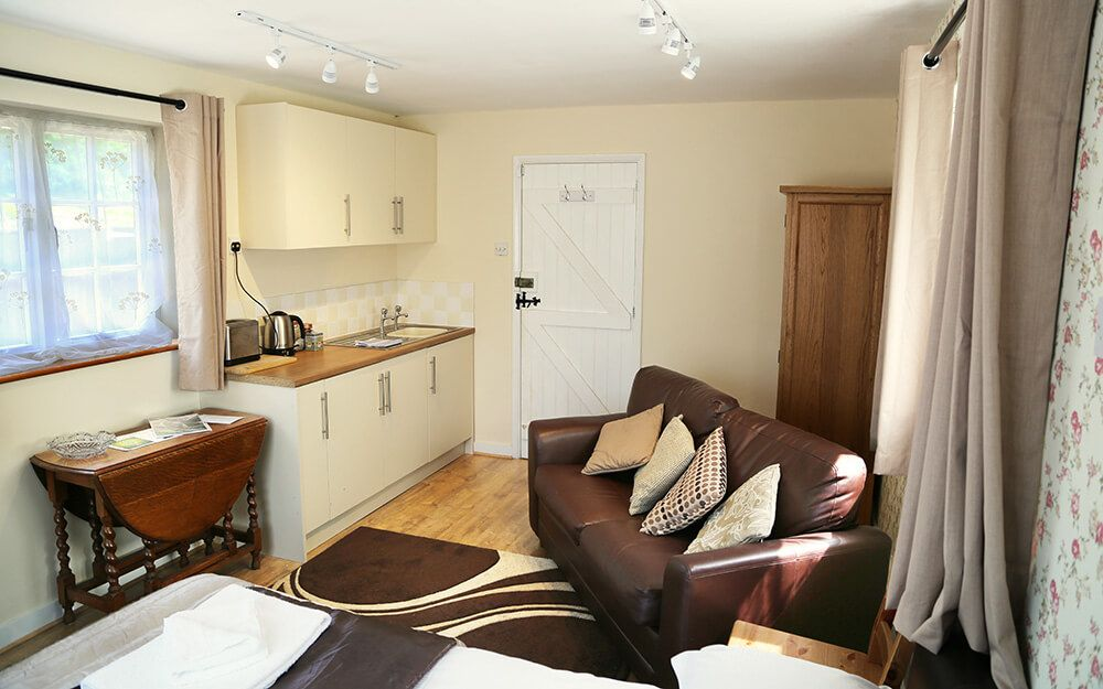 Kitchenette and seating area in the delightful self contained double studio to Larkin Farmhouse