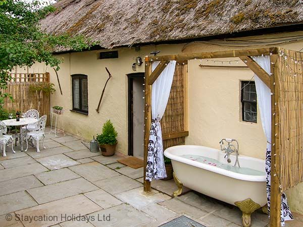 Charming south facing terrace with roll-top bath and star lights