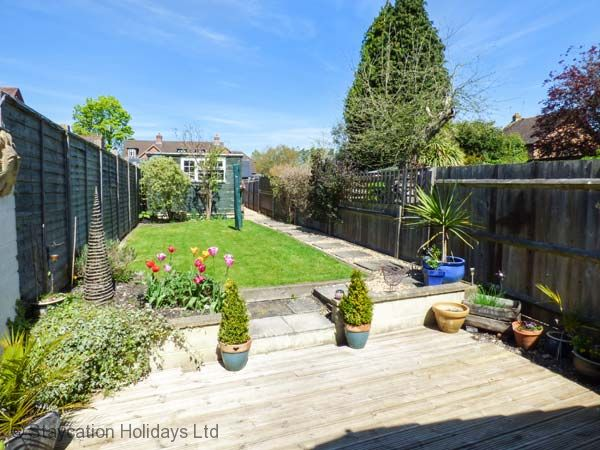Relax in the enclosed lawned garden & enjoy refreshments on the decked patio
