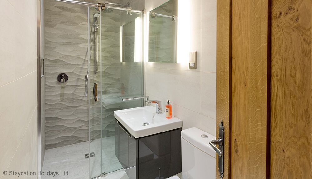 Waternook first floor: Fusedale - En suite natural stone shower room with monsoon and raindrop shower