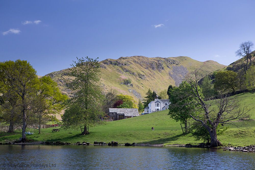 The dramatic setting is complemented by half a mile of Ullswater shoreline, and a boathouse with private jetty