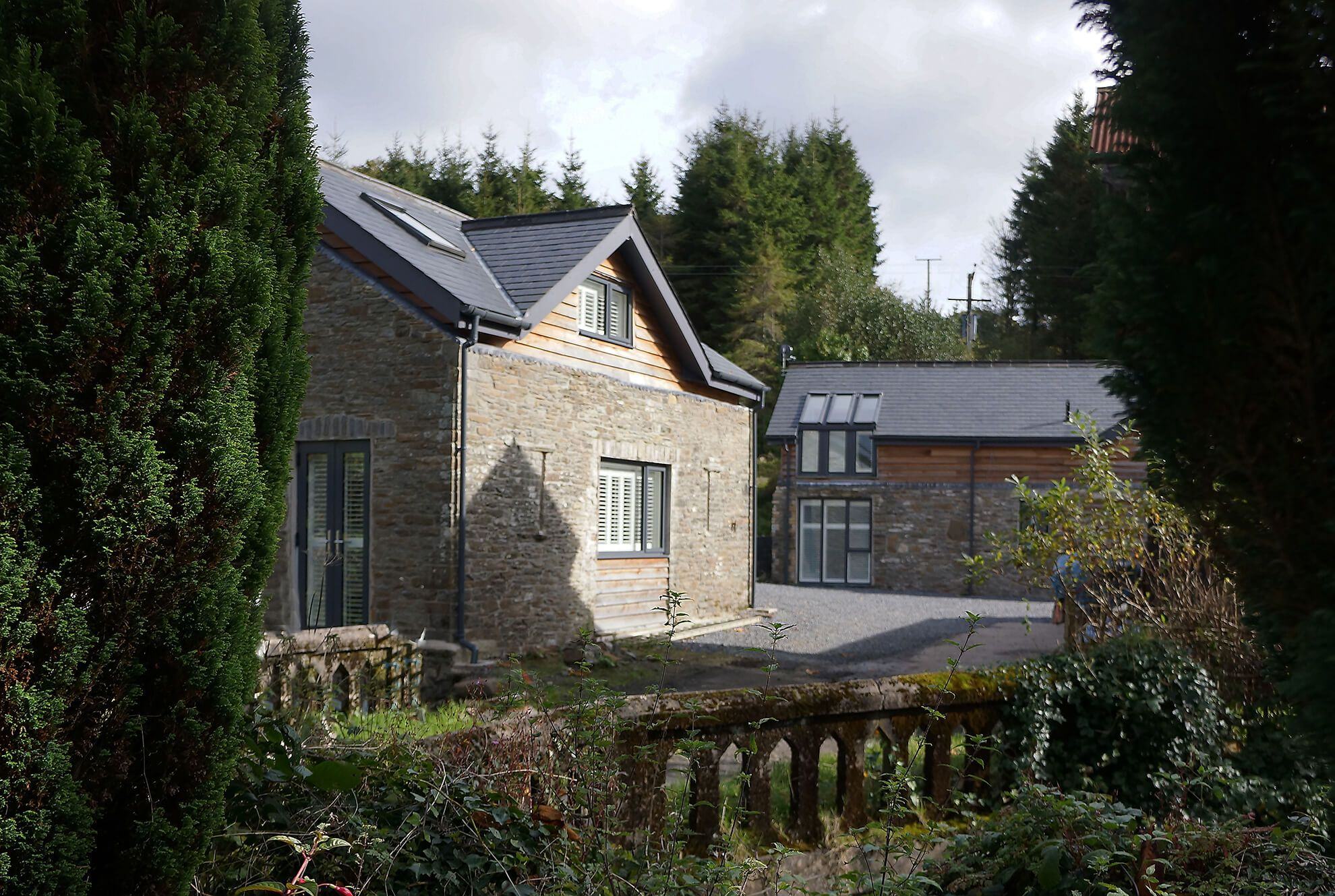 Lloc Llo is located by the old bridge into the farmyard