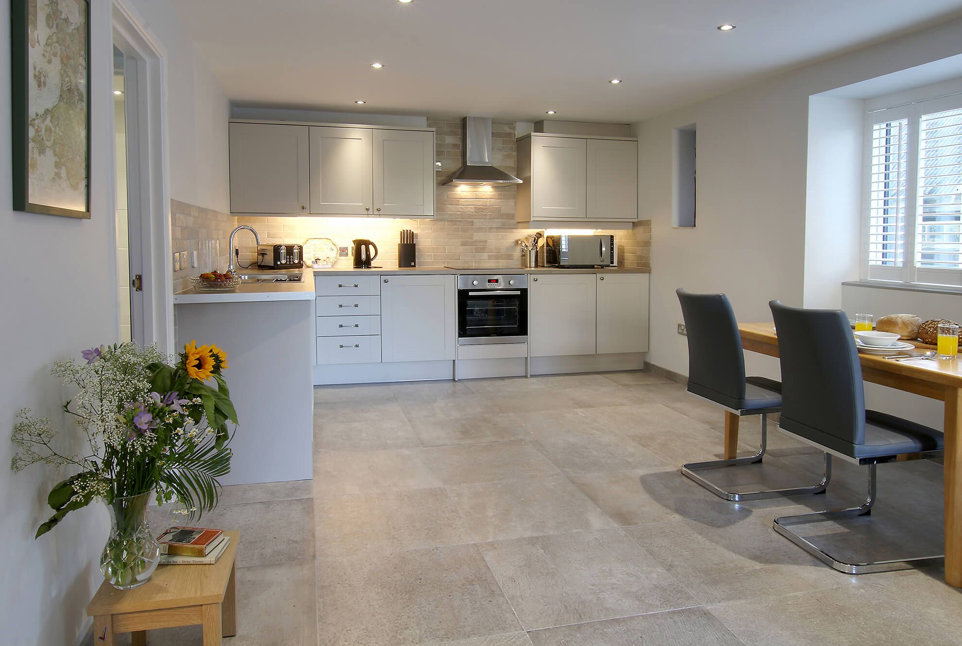 Ground floor: Stylish and well equipped open plan kitchen