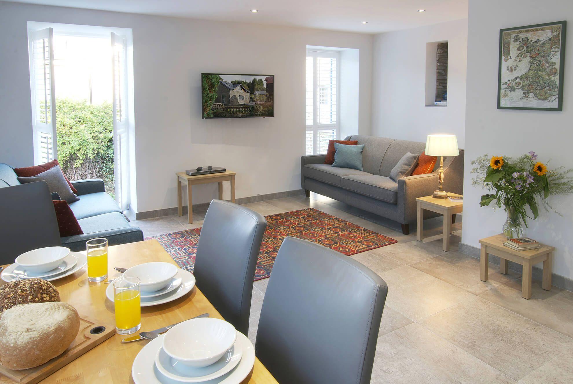 Ground floor: Lounge-diner with door to riverside terrace