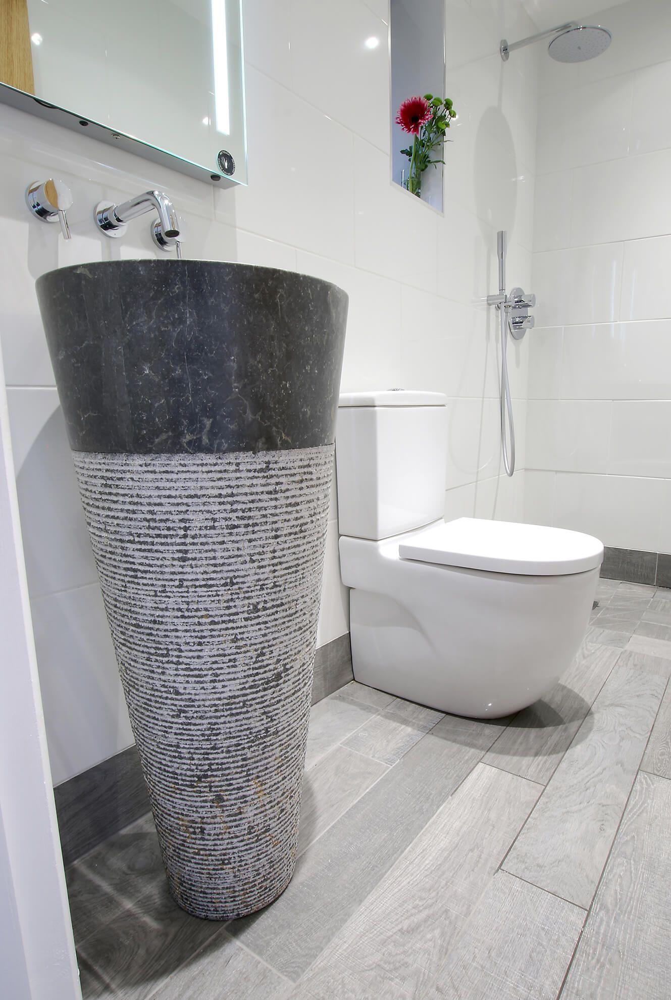 Ground floor: Modern minimalist wetroom with walk-in rainforest shower and standalone marble sink
