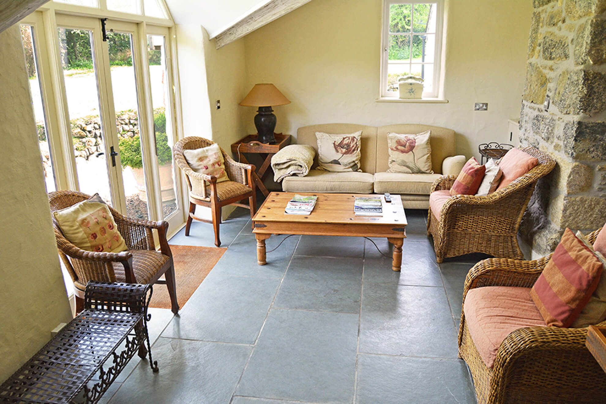 Ground floor: Sunny garden room with comfortable seating