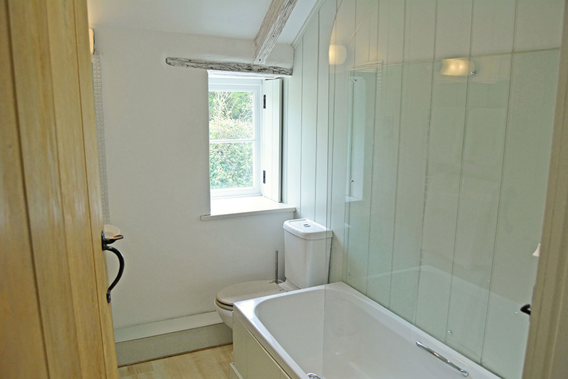 First floor: En suite bathroom to double bedroom with super-king size bed