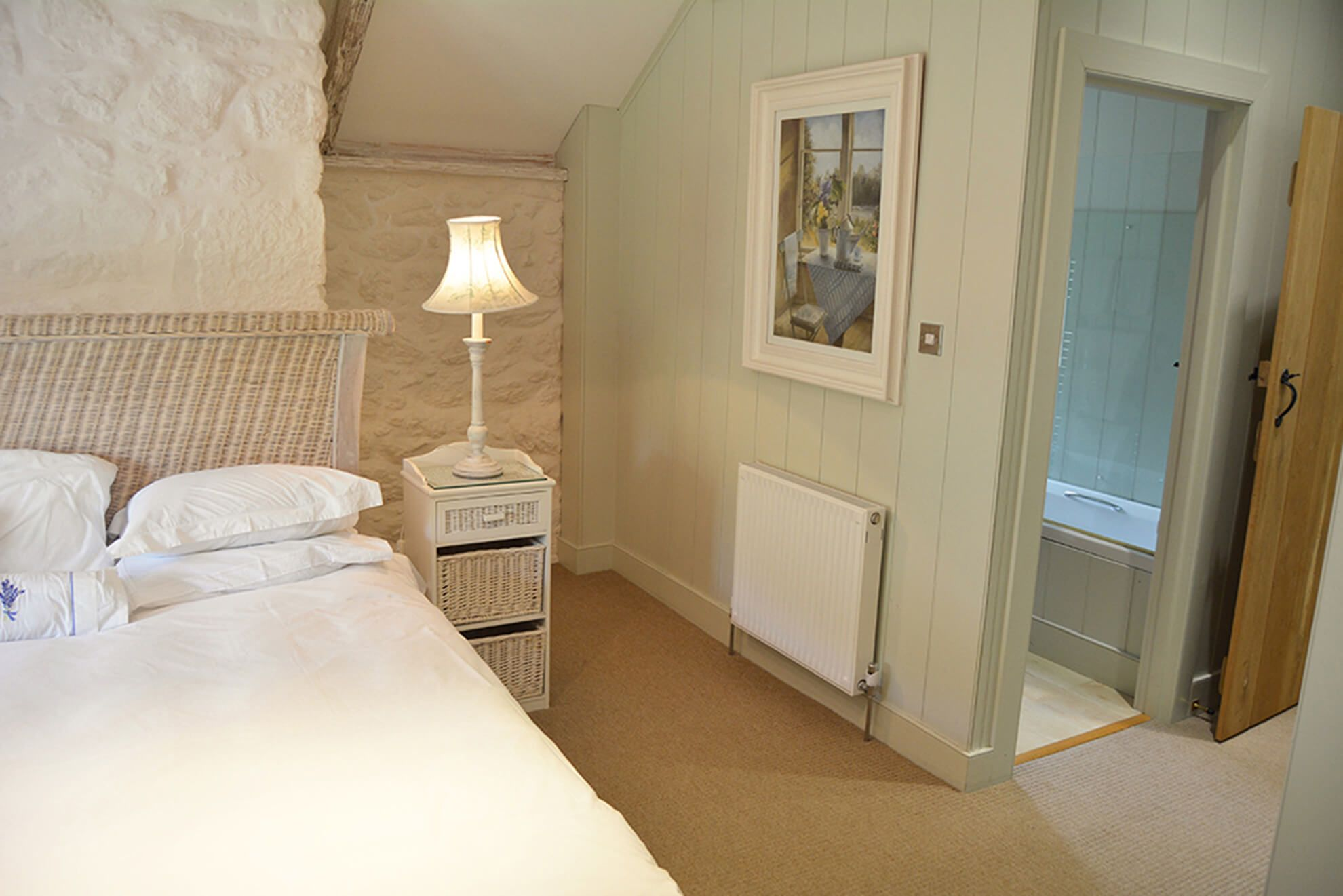 First floor: Double bedroom with super-king size bed, vaulted ceilings and en suite bathroom