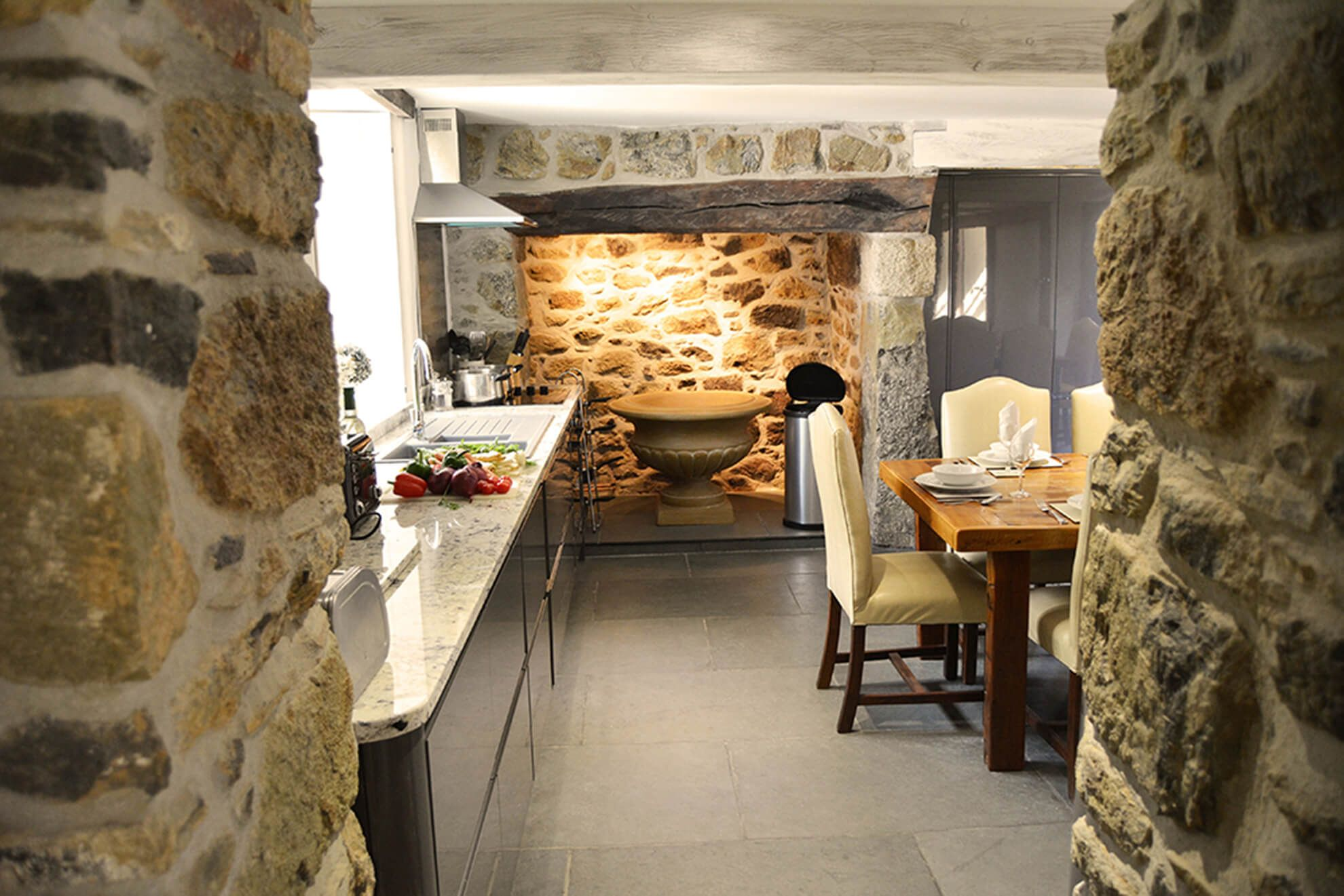 Ground floor: Kitchen through to dining room with original fireplace