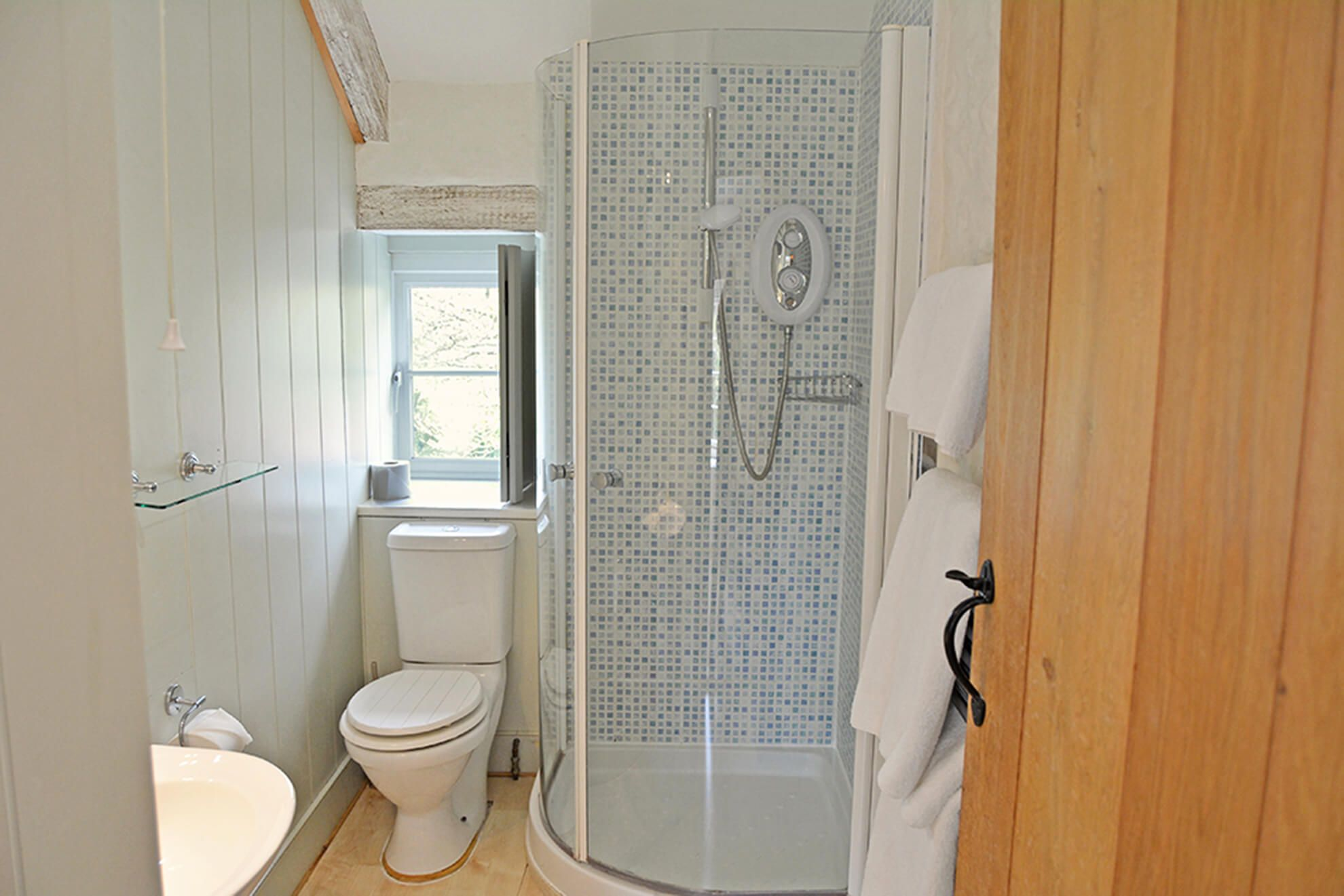 First floor: En suite shower room to double bedroom with super-king size bed