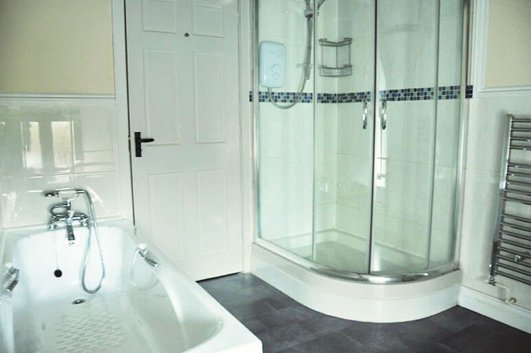 First floor: Large bathroom with a separate double shower cubicle