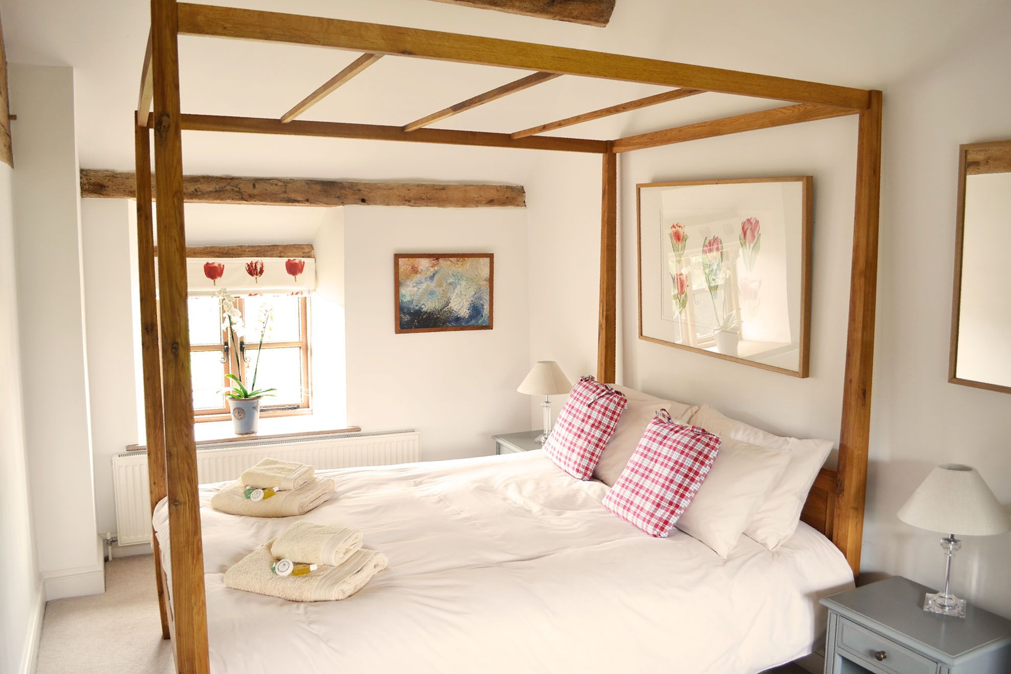 First floor: Spacious double bedroom with a 5' four poster bed