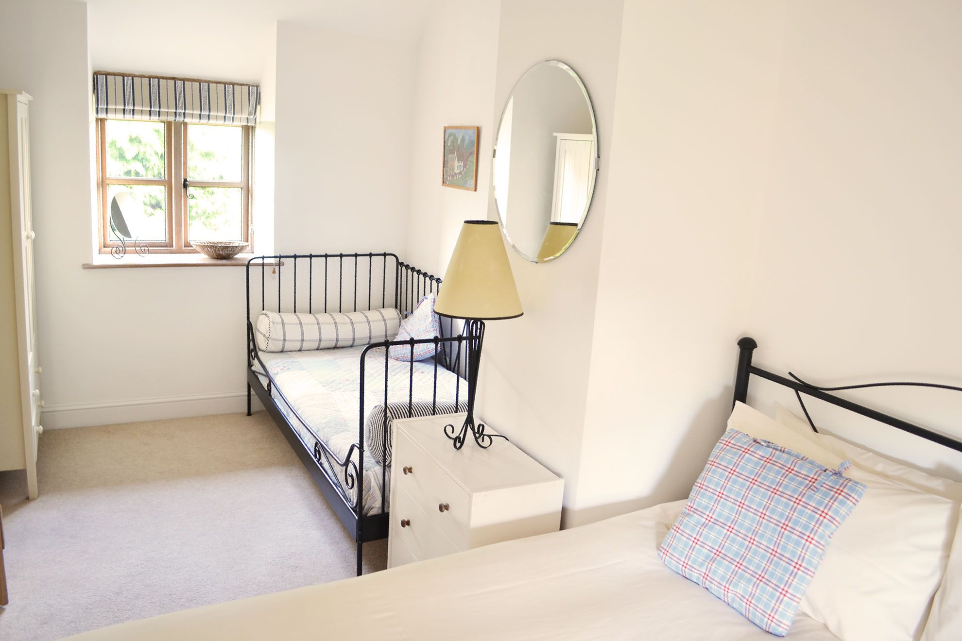 First floor: Spacious double bedroom with a 5' bed and a day bed