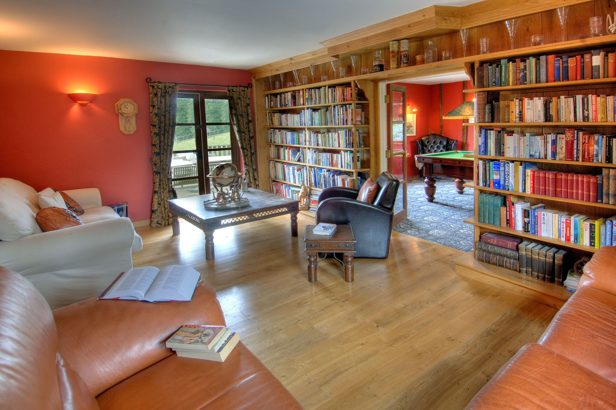 The Barn ground floor: Extensive library in the sitting room & billiards room