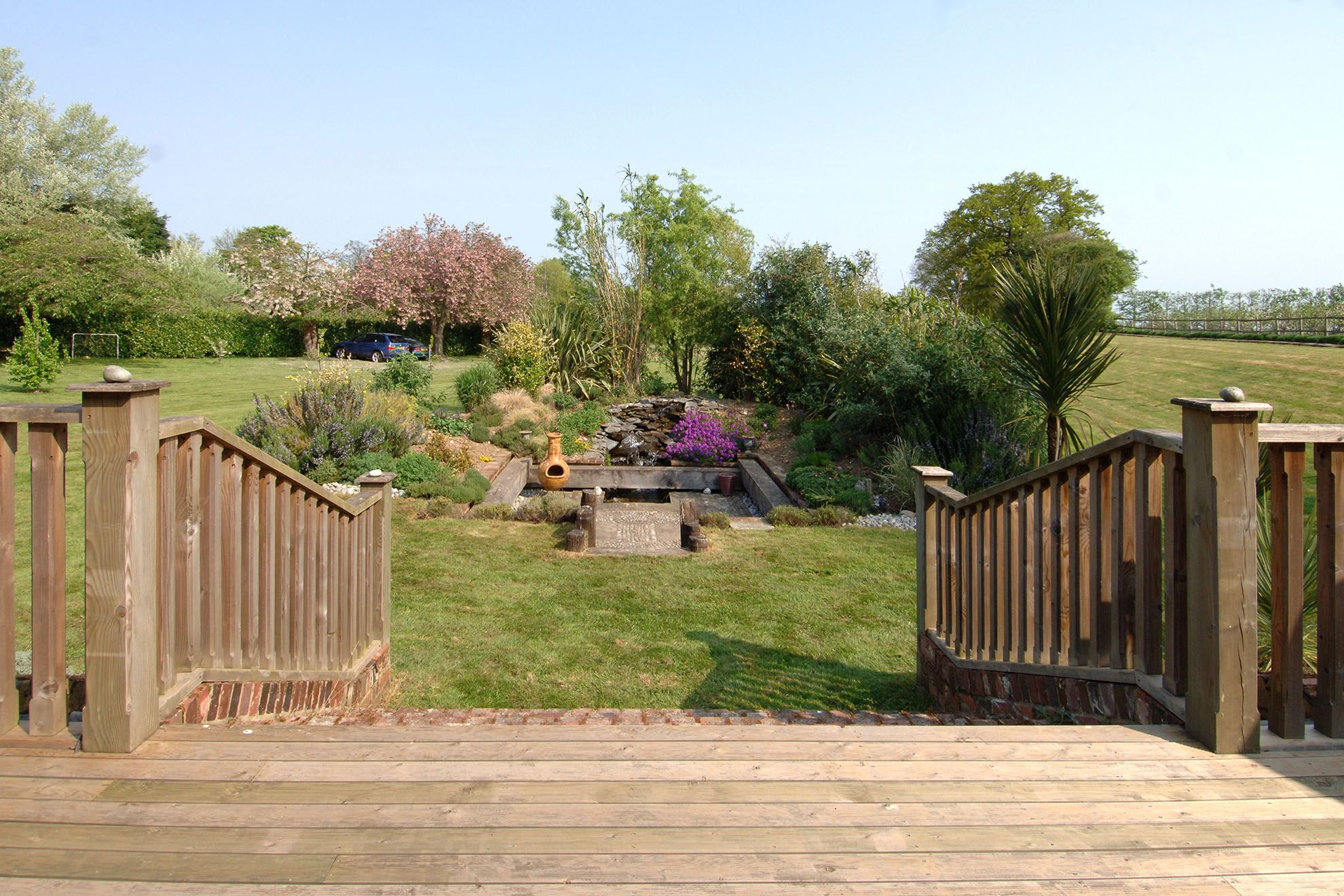 View from The Barn of the beautifully landscaped gardens and water feature