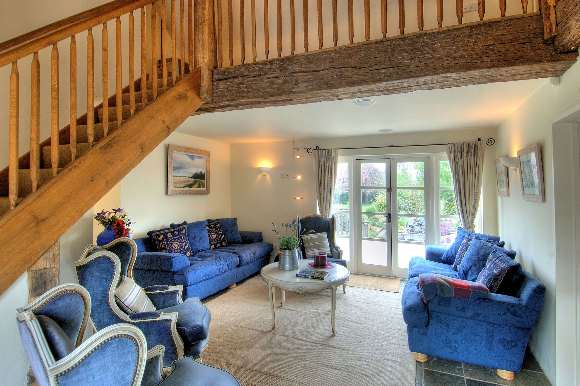 The Barn ground floor: Dining and lounge area with doors to the main decking