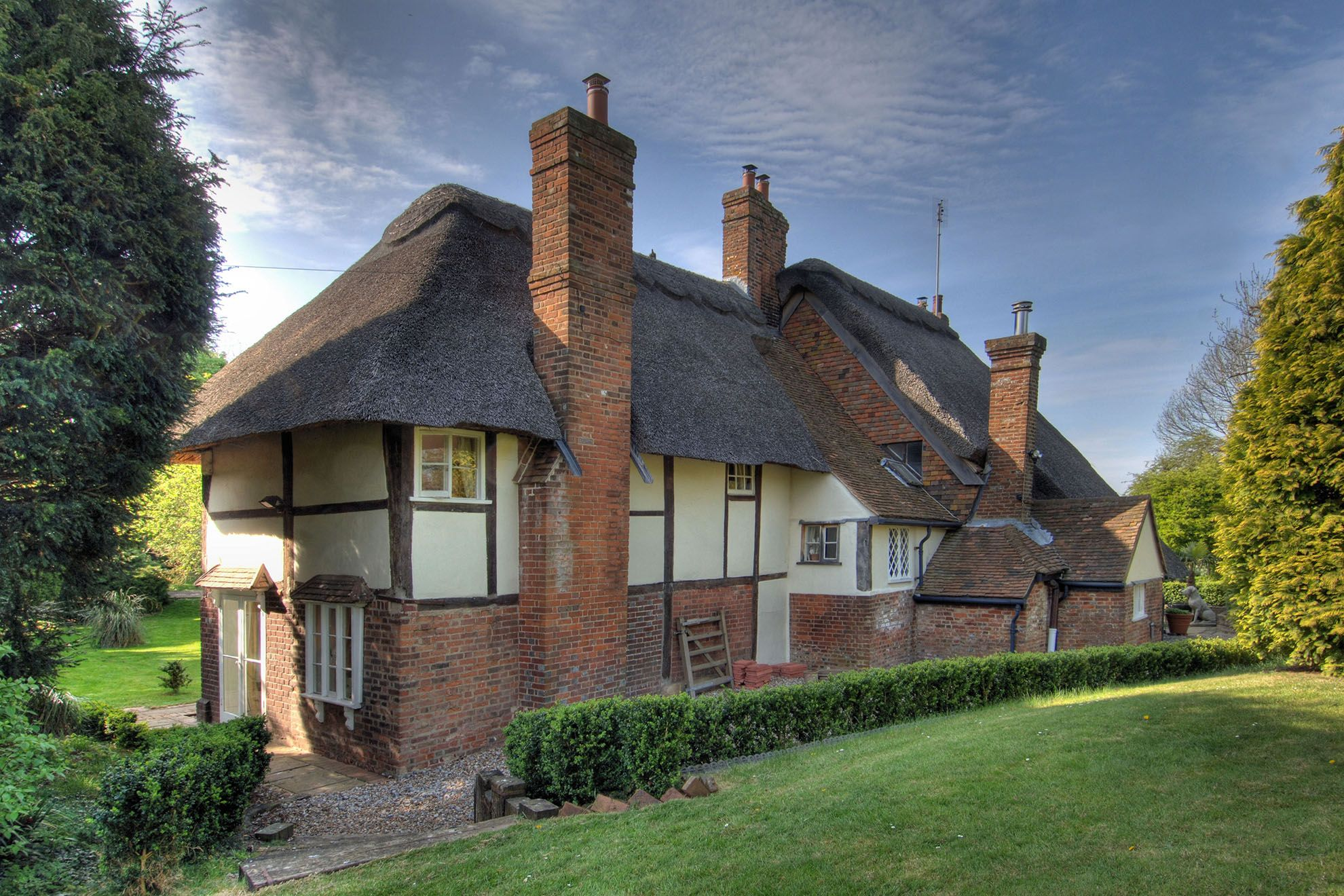 The focal property is the 15th century thatched Farmhouse, sleeping seven