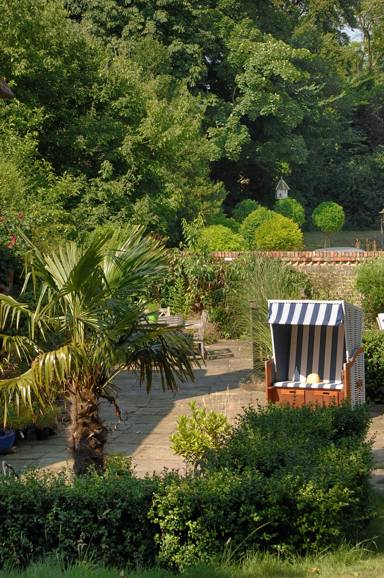 Two acres of beautifully landscaped gardens to roam around, with private decked sitting areas
