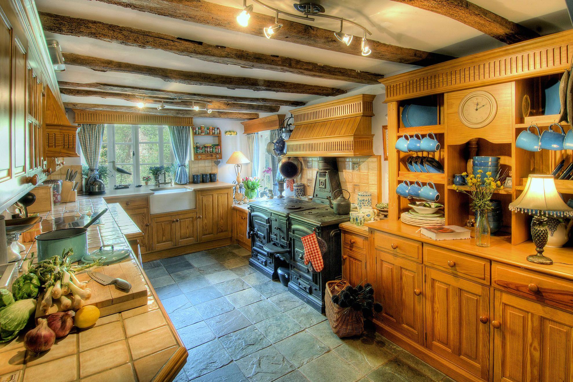 The Farmhouse ground floor: Kitchen/breakfast room with cast iron range