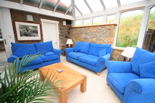The lovely conservatory offers a quiet area to relax