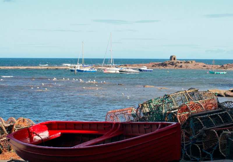 Boats at Seahouses and the famous Powderhouse