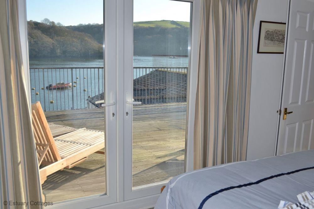 Bedroom with doors onto patio