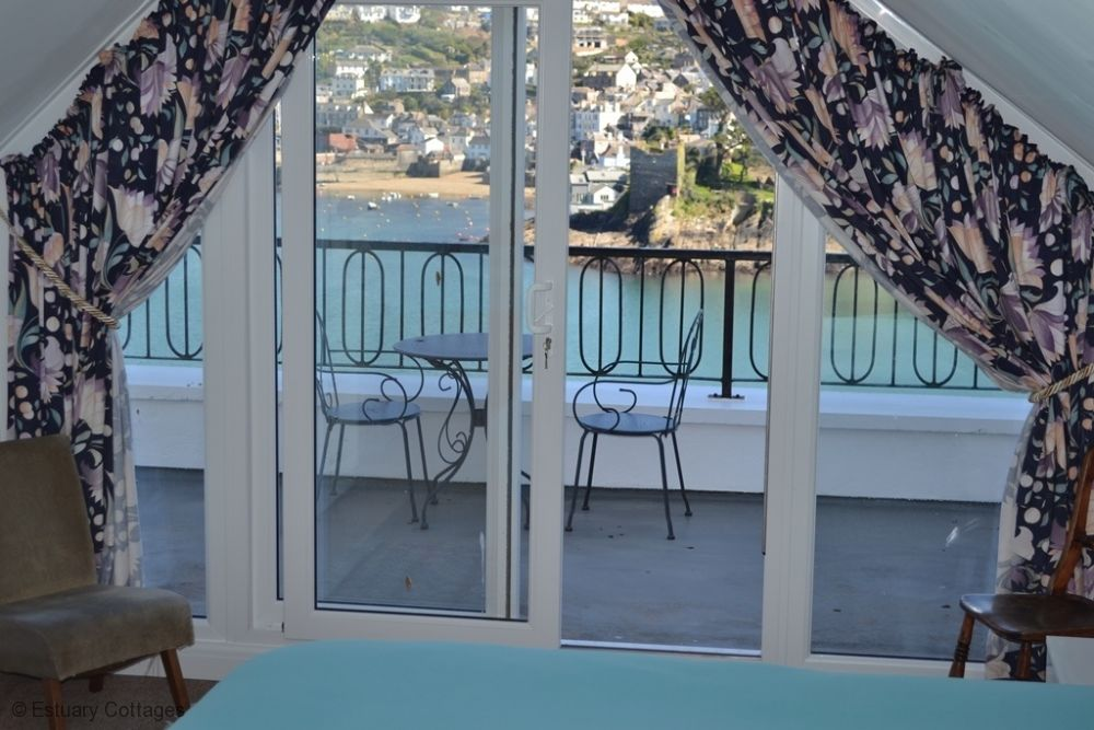 Master Bedroom with doors onto balcony with lovely views