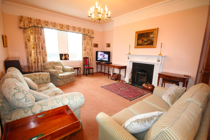 The drawing room with open fire, TV with dvd and comfy seating