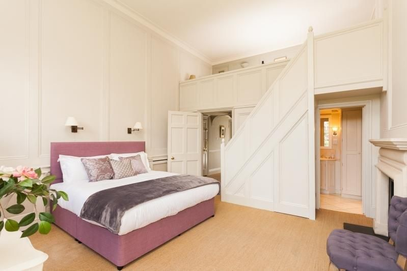 Master bedroom with stairs leading to open galleried single bedroom
