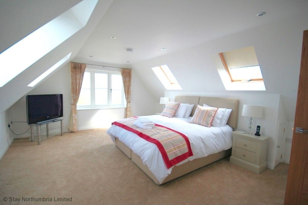 Attic bedroom showing roof eaves.
