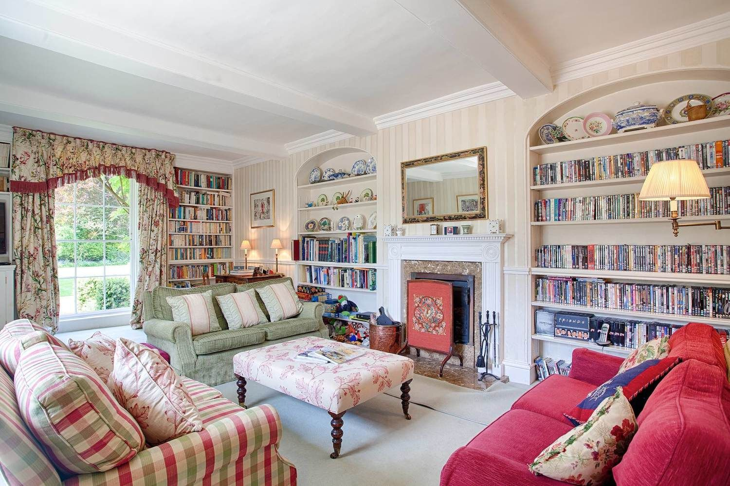 Ground floor: Sitting room with log fire, large flat screen TV & DVD library