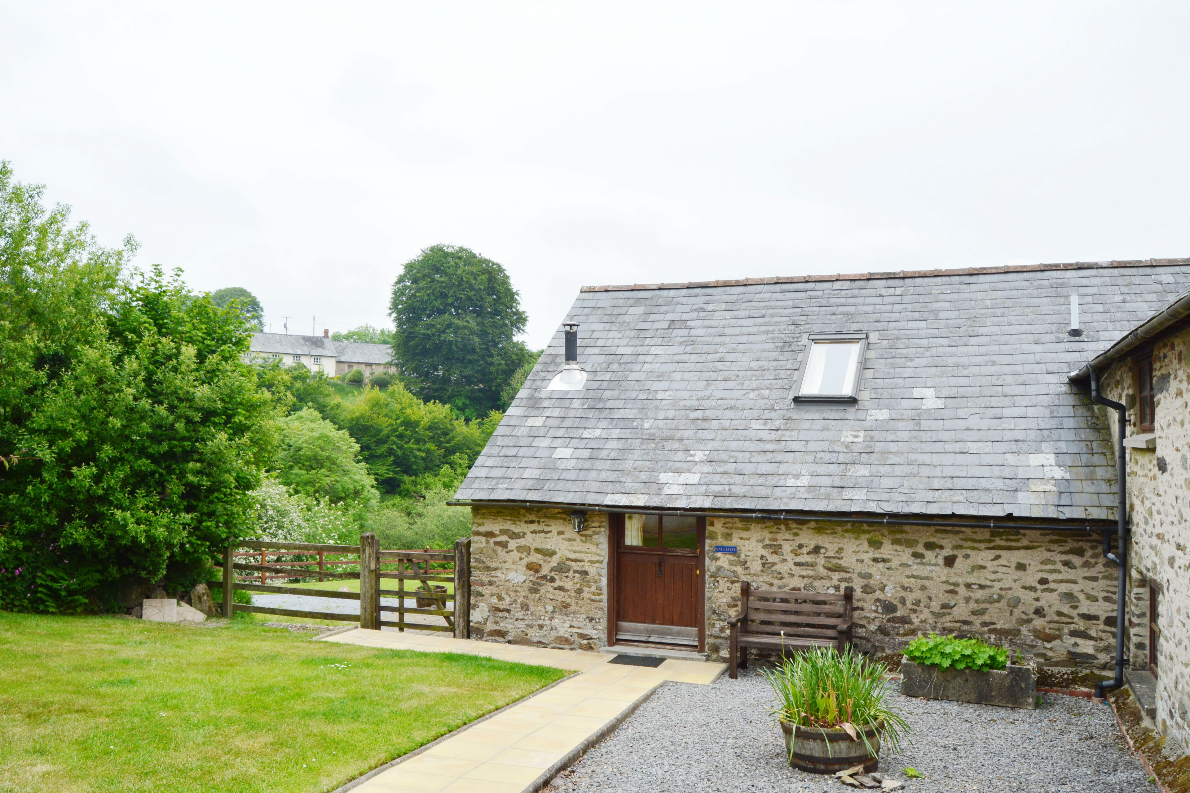 Smiddy is set slightly away from the 3 other cottages at West Hollowcombe Farm