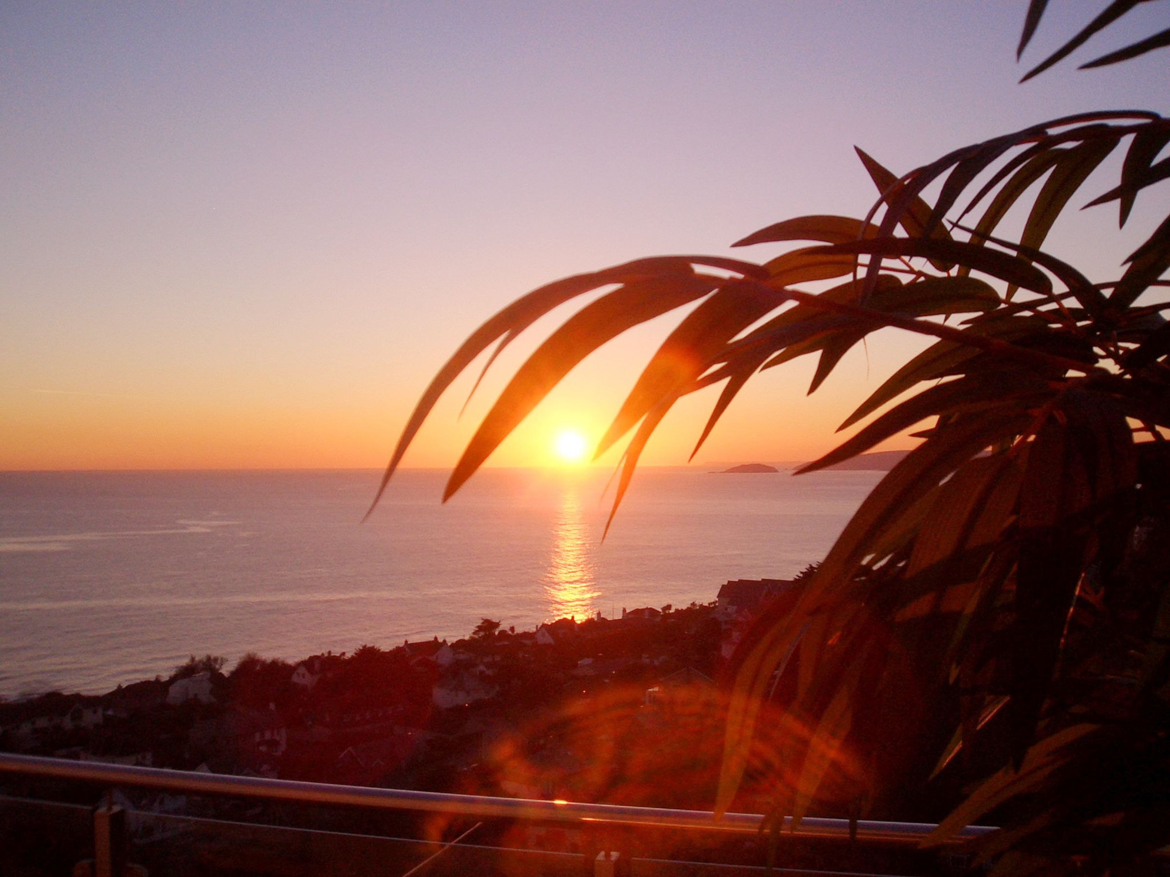 A winter sunset viewed from the balcony overlooking the bay