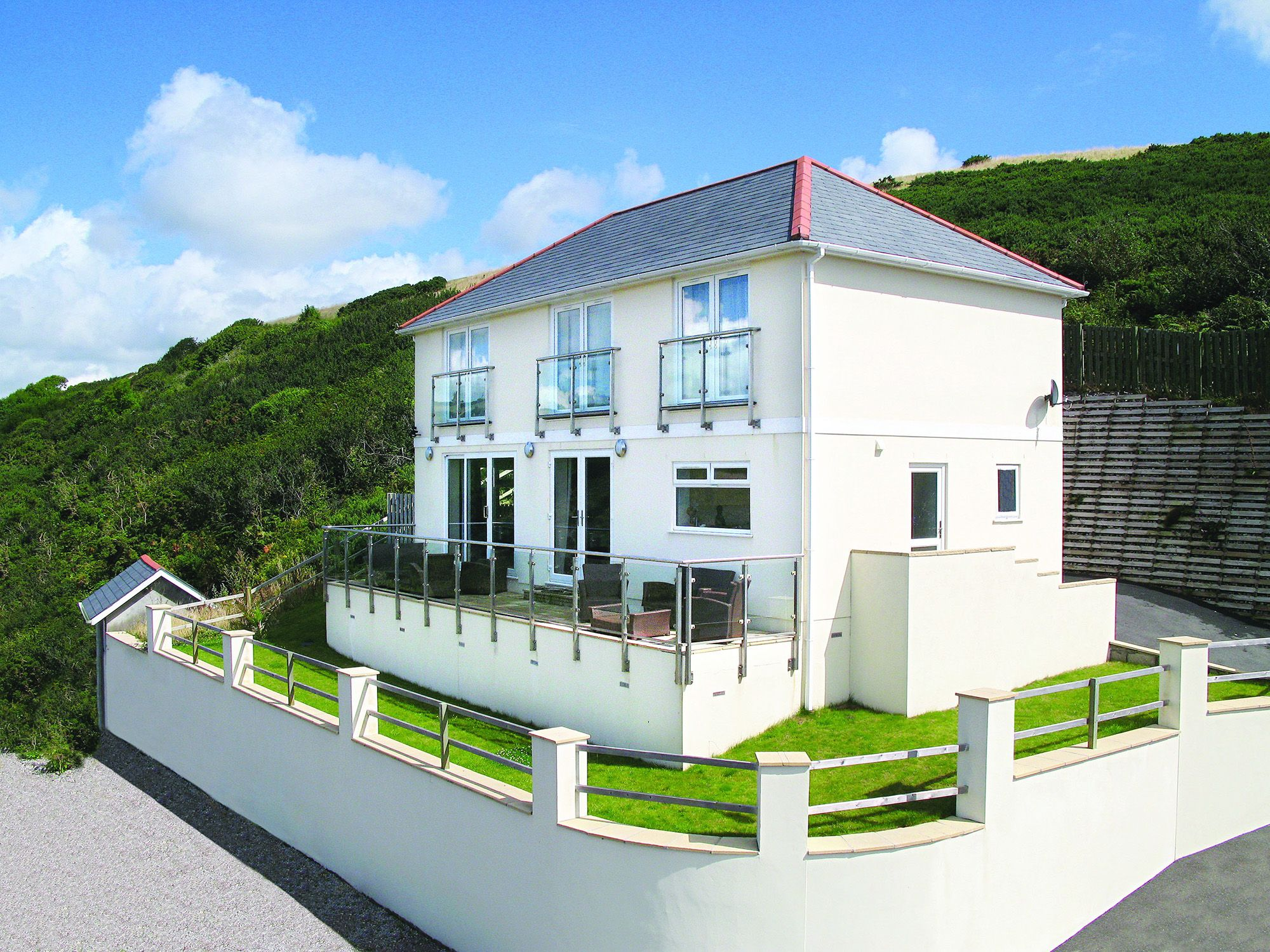 Looe Island View is a 5 star holiday home sleeping 10 in a hillside location