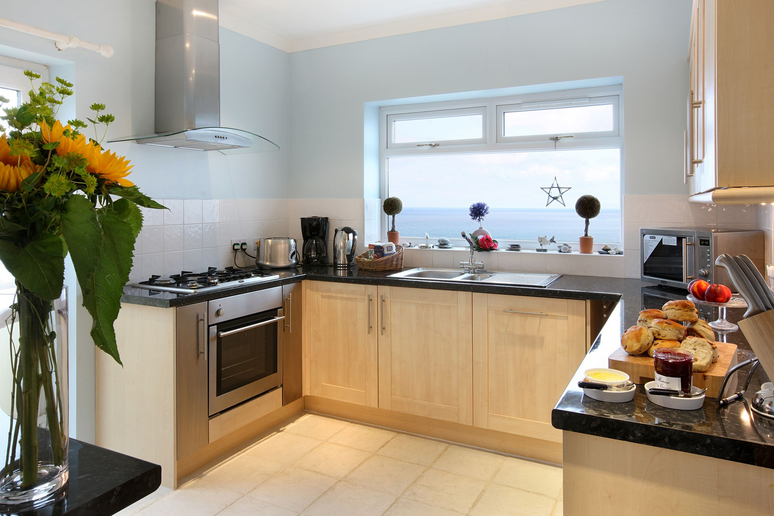 Ground floor: Well appointed modern fully fitted kitchen with superb sea views
