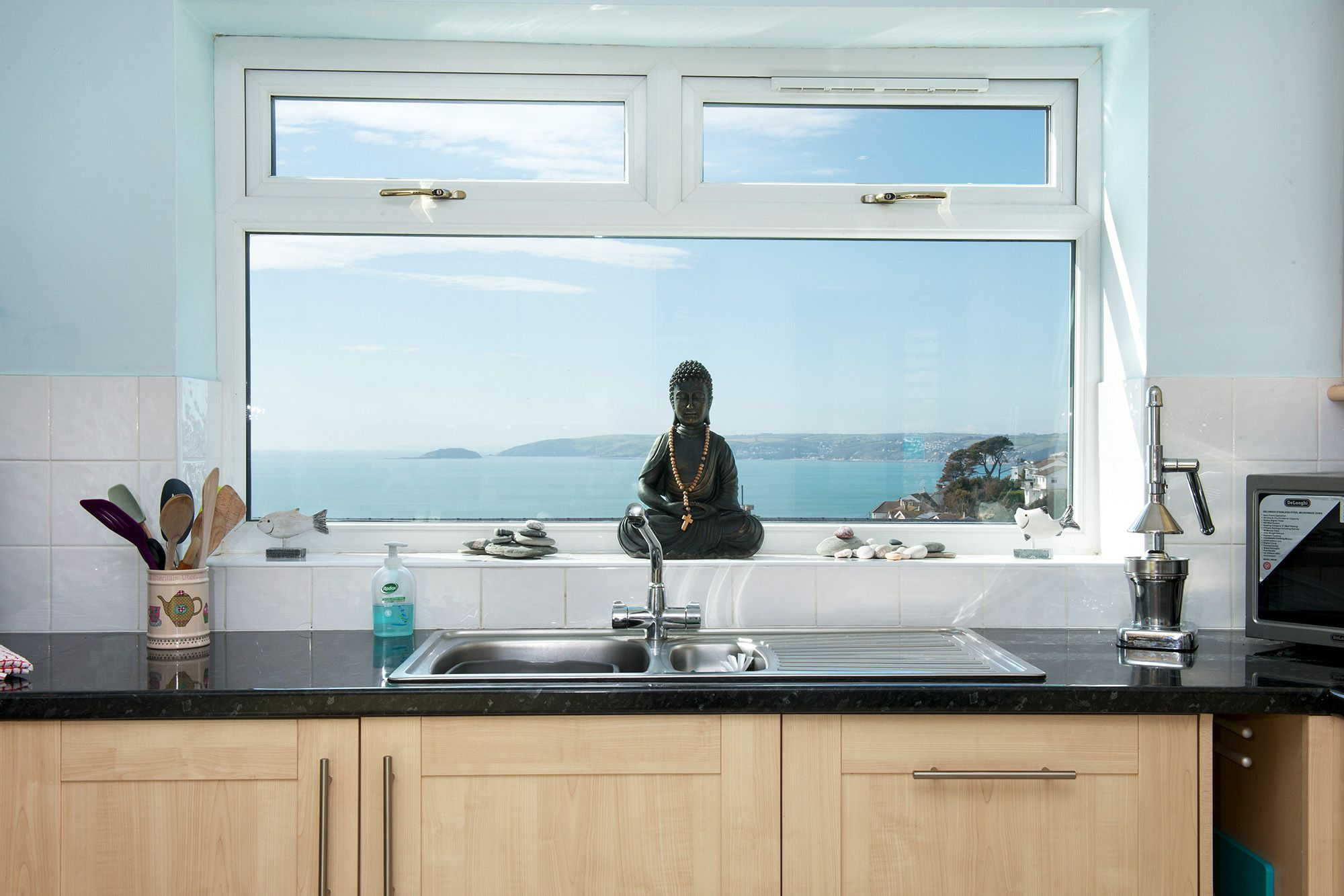 Ground floor: The superb sea and coastal views from the well appointed kitchen