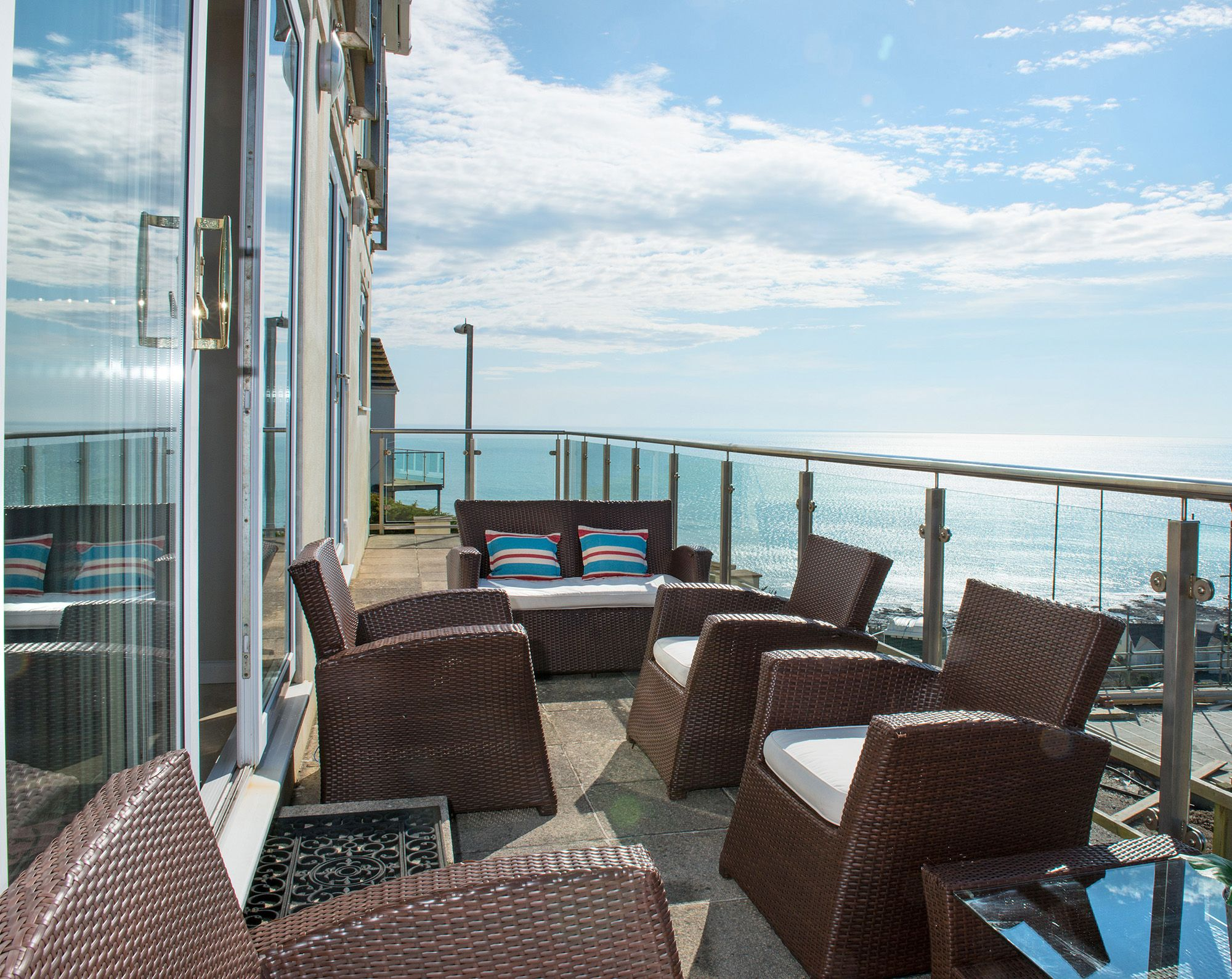 Ground floor: Full length balcony off the living area with stunning sea views