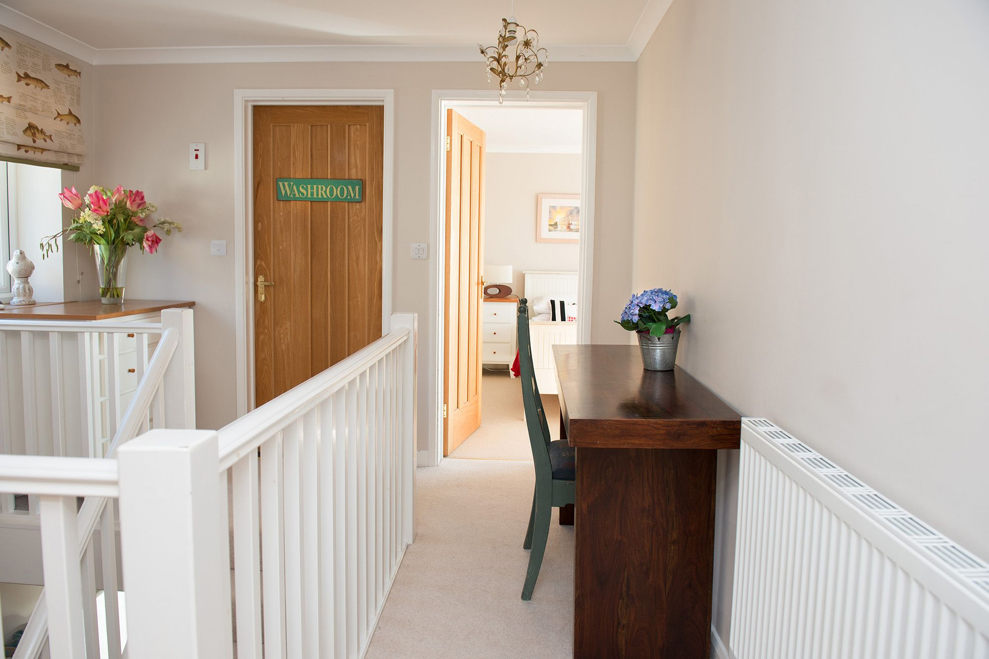 First floor: Landing with entrance to the twin bedroom