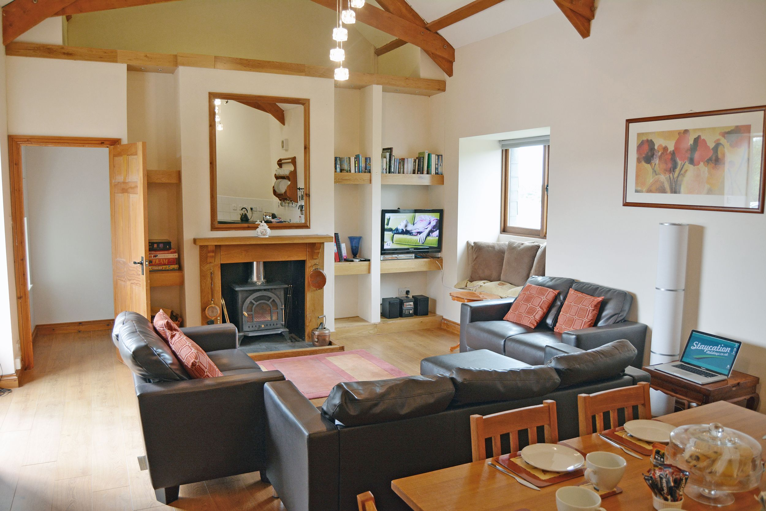 Ground floor: Spacious open plan sitting area with a wood burning stove