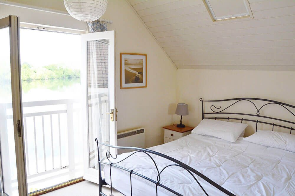 First floor: Master bedroom with a 6' bed affords stunning lake views