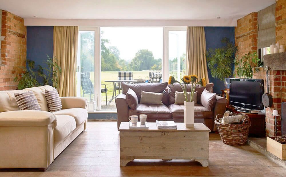 Ground floor: Sitting room with open log fire and countryside views