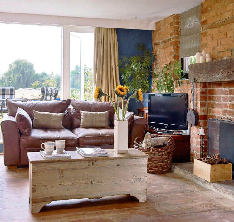 Ground floor: Sitting room with exposed brickwork, log fire and oak flooring